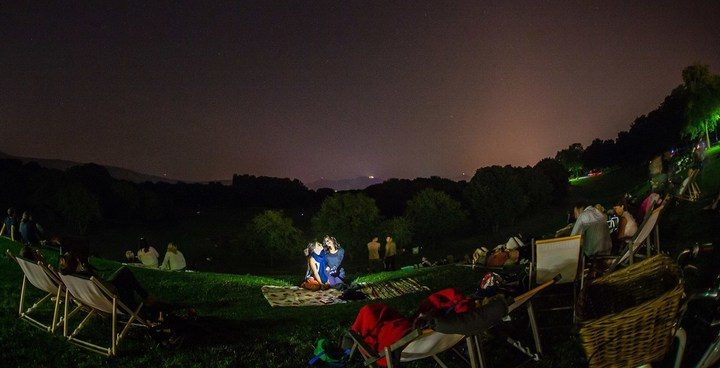 People gather for a public viewing to watch the sky and falling stars in Bonn, western Germany, during the peak in activity of the annual Perseids meteor shower on August 13, 2015. The Perseids meteor shower occurs every year when the Earth passes through the cloud of debris left by Comet Swift-Tuttle.   AFP PHOTO / DPA / VOLKER LANNERT   +++   GERMANY OUT
